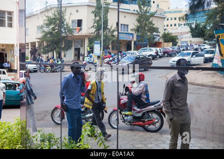 Street scene in downtown Kigali reflected on modern building, Rwanda. - Stock Image