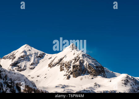 Snow blowing off the mountain tops near Obertauern, Austria - Stock Image