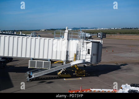 Airplane bridge is the walkway to airplane for passengers. Airplane bridge allows passengers to enter or leave the plane.  Nashville International Air - Stock Image