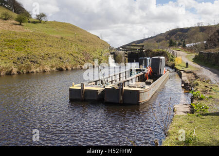 Canal maintenance boat moored on the Rochdale canal in the village of Walsden near the Lancashire/Yorkshire border. - Stock Image