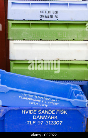 Fish Boxes, stacked in harbour Gilleleje, Sjaelland, Denmark - Stock Image