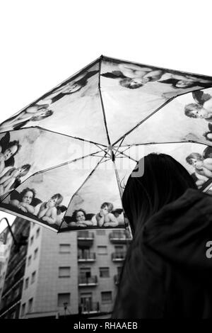 Girl with kitsch decorated umbrella - Stock Image