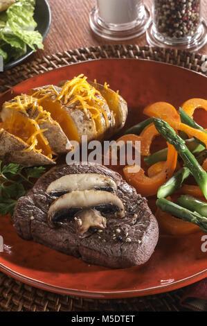 Beef & Baked Potato Dinner - Stock Image
