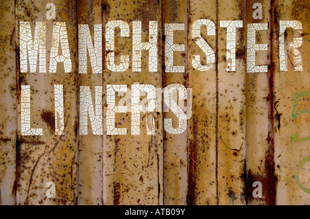 manchester liners old cargo container freight pink rusty decay transportation - Stock Image