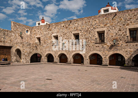 The facade of the San Francisco Convent in the Plaza de Aranzazu in the state capital of San Luis Potosi, Mexico. The chapel and convent was built between 1749 and 1760 and features Churrigueresque details and tiled domes. - Stock Image