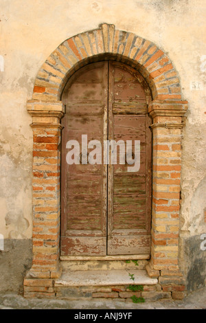 Typically unrestored ,charming, old door in Offida,Le Marche,Italy - Stock Image