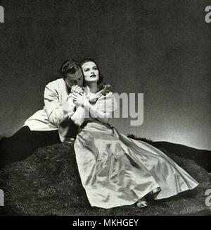 Man Kisses Woman's Hand - Stock Image
