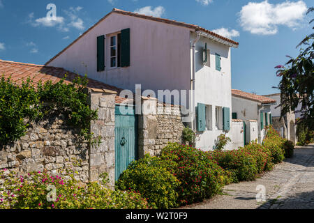 french houses in the streets of Saint Martin de re on a sunny day - Stock Image
