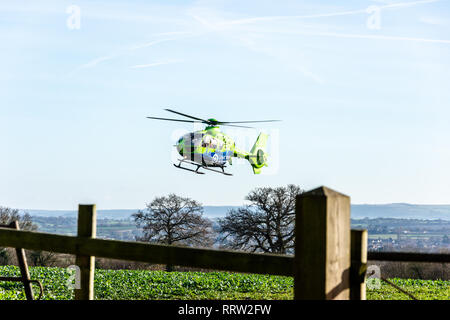Bradford Leigh Wiltshire UK January 9th 2019 The Great Western air ambulance helicopter taking off from a field - Stock Image