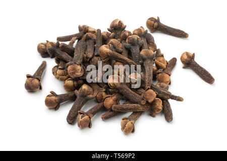 Heap of aromatic dried cloves isolated on white background - Stock Image