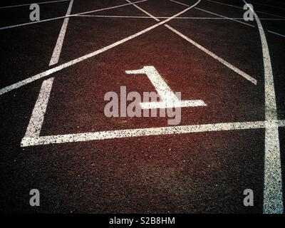 Number 1 on an athletic field track - Stock Image