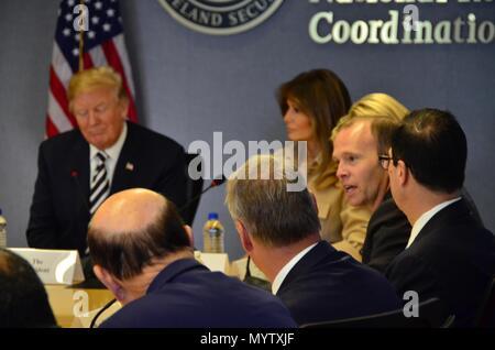 FEMA Administrator Brock Long, center, briefs U.S President Donald Trump, First Lady Melania Trump and members of the cabinet on the annual hurricane season preparations at FEMA Headquarters June 6, 2018 in Washington, DC. - Stock Image
