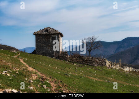 Old stone abandoned house in the mountain - Stock Image