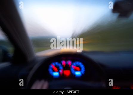 Automobile dashboard while driving on country road, Vermont, USA - Stock Image