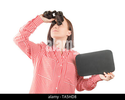 Woman holding blank slate with copy space looking through the binocular. Isolated on white - Stock Image