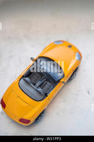 Yellow convertible toy car - Stock Image