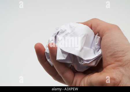 crumpled paper ball in hand - Stock Image
