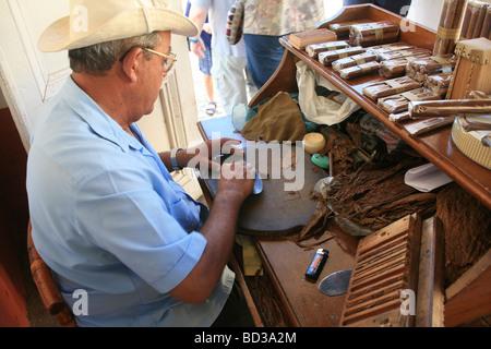 Cuba Trinidad A roller preparing cigars in La Canchanchara bar and restaurant Photo CUBA1455 Copyright Christopher - Stock Image
