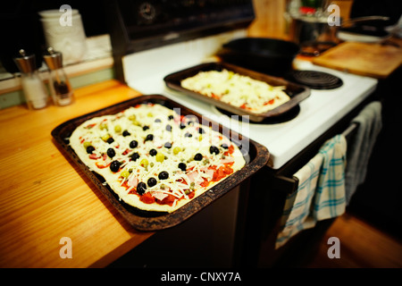 Homemade pizza ready to go in oven. - Stock Image