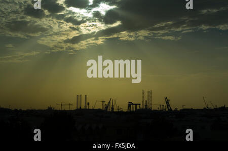 Dramatic sky over construction sites in Dubai, UAE - Stock Image