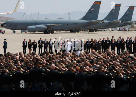Arizona National Guardsmen salute as the U.S. Military joint honor guard carries the casket of Sen. John McCain to a Boeing C-32 military airplane for a dignified transfer Aug. 30, 2018, at the Goldwater Air National Guard Base in Phoenix. McCain, a six-term Republican Senator from Arizona who lost his battle with brain cancer earlier this week, will be flown to Washington D.C. for a ceremony at the U.S. Capitol before being buried in Annapolis, Maryland. (Arizona Army National Guard photo by Staff Sgt. Brian A. Barbour) - Stock Image