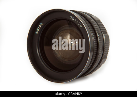 Old vintage Soviet lens isolated ower white - Stock Image