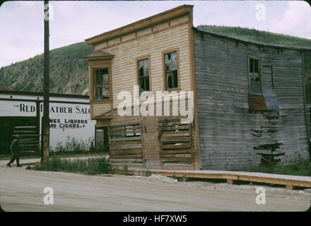 Old house in Dawson; Yukon Territory, Canada.  Note: Building damaged from shifting ground caused by thawing permafrost. - Stock Image
