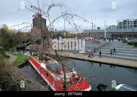 A boat moored at Regents Canal near Coal Drops Yard & Granary Square in winter in the Kings Cross area of  London NC1 England UK    KATHY DEWITT - Stock Image
