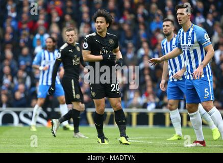 Shinji Okazaki of Leicester (C) and Lewis Dunk of Brighton (R) during the Premier League match between Brighton and Hove Albion and Leicester City at the American Express Community Stadium in Brighton and Hove. 31 Mar 2018 *** Editorial use only. No merchandising. For Football images FA and Premier League restrictions apply inc. no internet/mobile usage without FAPL license - for details contact Football Dataco *** - Stock Image