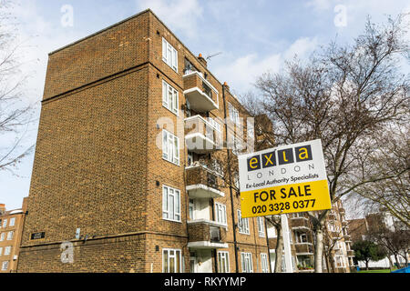 A sign for Exla estate agents. Specialists in selling ex-local authority properties. - Stock Image