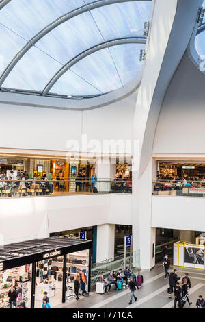 Birmingham Grand Central retail plaza above New Street Station with the dramatic transluscent roof showing cafes and retailers. - Stock Image