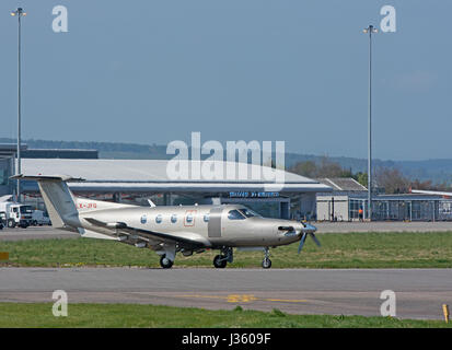 Al Luxumberg registered Pilatus PC-12 Aircraft lining up on 05 runway prior to departure from Inverness Dalcross - Stock Image