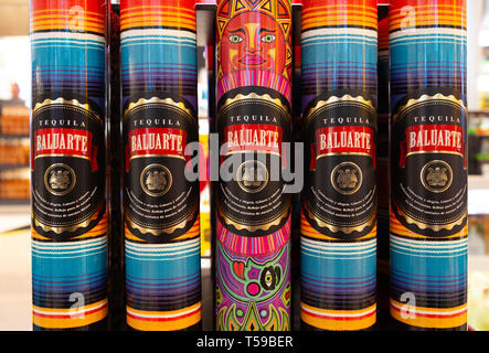 Close up of bottles of Baluarte Tequila on the shelf, Cancun Mexico - Stock Image