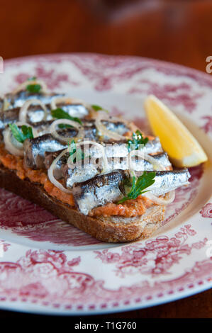 'Anchovies on bread in cocktail lounge of The Zetter Townhouse in London, England' - Stock Image