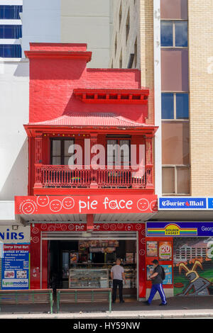 A franchise store of the Pie Face chain, in central Brisbane, Australia. This chain has a bold, bright image. Painted - Stock Image