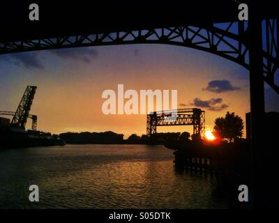 Cuyahoga river at sunset with bridges in Cleveland Ohio. - Stock Image