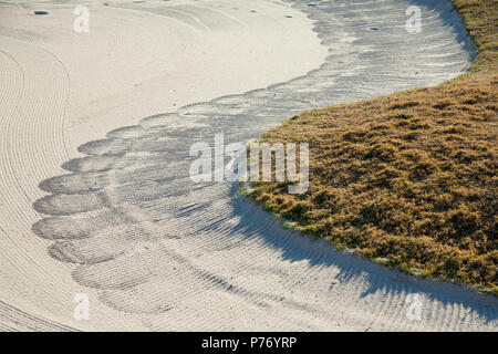 Close up of raked sand patterns in golf bunker - machine raked sand traps. - Stock Image