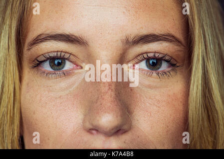 Close-up of young woman's face and eyes - Stock Image