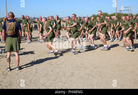 Recruits of Kilo Company, 3rd Recruit Training Battalion, conduct sprint drills during a physical training session - Stock Image