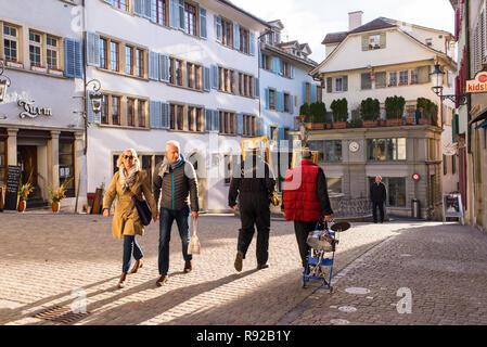Zurich, Switzerland - March 2017: People walking in Spiegelgasse, a narrow street in the Old Town of Zurich, Switzerland - Stock Image