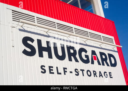 Colourful Shurgard sign on the side of a Shurgard self-storage facility in Caversham, Reading, Berkshire. - Stock Image