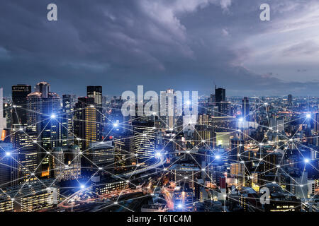 Network business connection system on Osaka smart city scape in background. Network business connection concept - Stock Image