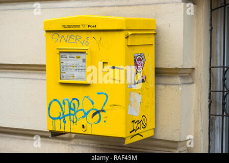 Yellow postbox with graffiti, Vienna, Austria, Europe. - Stock Image