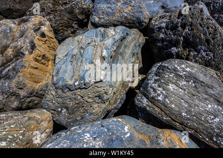 Rocks used as Breakwater. - Stock Image