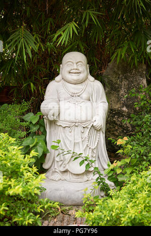 Statue of Buddha in the front garden of Phap Bao Buddhist temple in the town of Hoi An, Central Vietnam. - Stock Image