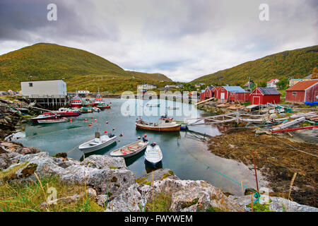 The harbor of fishing village Rødsand on island Senja in northern Norway on a cloudy summer day - Stock Image