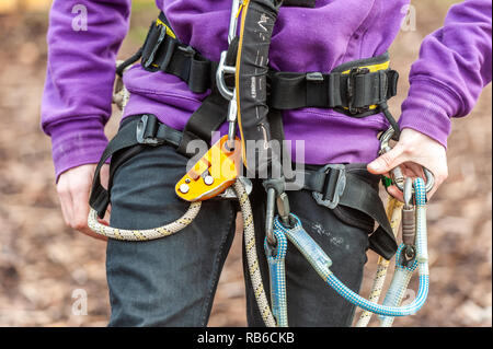 Outdoor Activity Centre Instructor with safety harness around his waist. - Stock Image