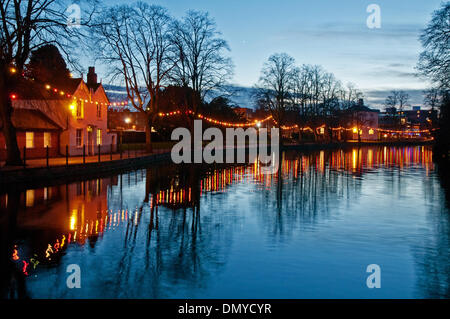 Lichfield, UK. 17th Dec, 2013. Christmas lights on Minster Pool walk Lichfield Staffordshire England with reflections colour and evening star Credit:  David Keith Jones/Alamy Live News - Stock Image