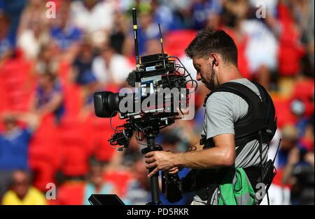Television Cameraman using a Steady-Cam during the FA Community Shield match between Chelsea and Manchester City at Wembley Stadium in London. 05 Aug 2018 - Stock Image
