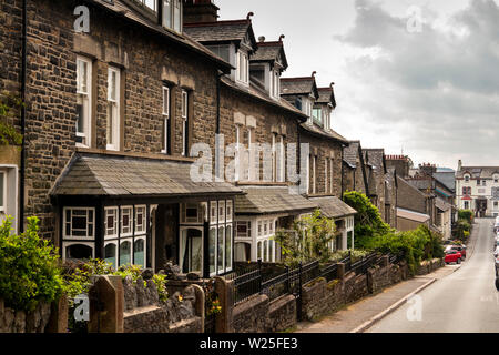 UK, Cumbria, Sedbergh, Bainbridge Road, substantial three storey stone-built Victorian houses in back street - Stock Image